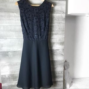Cachet hand beaded black fit and flare dress